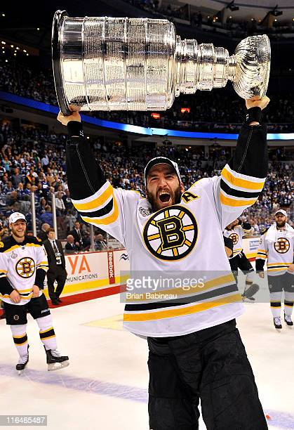Patrice Bergeron of the Boston Bruins celebrates by hoisting the Stanley Cup after defeating the Vancouver Canucks 4-0 in Game Seven of the 2011 NHL...
