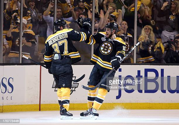 Patrice Bergeron of the Boston Bruins celebrates with Tyler Seguin after Bergeron scores in the second period against the Chicago Blackhawks in Game...