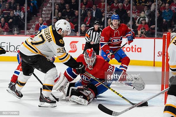 Patrice Bergeron of the Boston Bruins comes in alone on goaltender Mike Condon of the Montreal Canadiens and scores during the NHL game at the Bell...