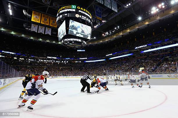 Patrice Bergeron of the Boston Bruins faces off against Aleksander Barkov of the Florida Panthers during the first period at TD Garden on March 24...