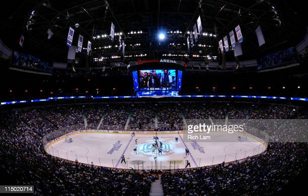 Patrice Bergeron of the Boston Bruins faces off against Henrik Sedin of the Vancouver Canucks to start game one of the 2011 NHL Stanley Cup Finals at...