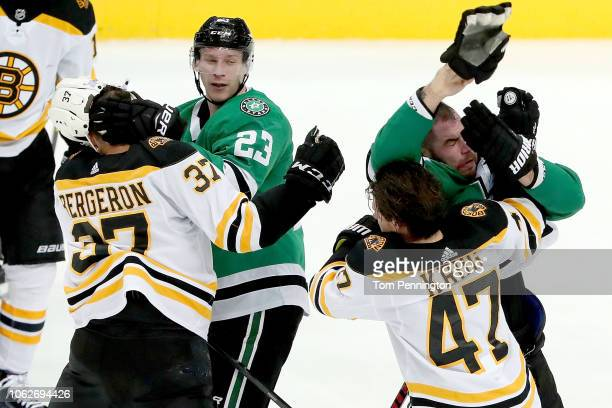 Patrice Bergeron of the Boston Bruins fight with Esa Lindell of the Dallas Stars as Torey Krug of the Boston Bruins fights with Roman Polak of the...
