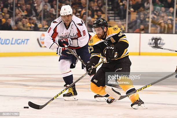 Patrice Bergeron of the Boston Bruins fights for the puck against Alex Ovechkin of the Washington Capitals at the TD Garden on January 5 2016 in...