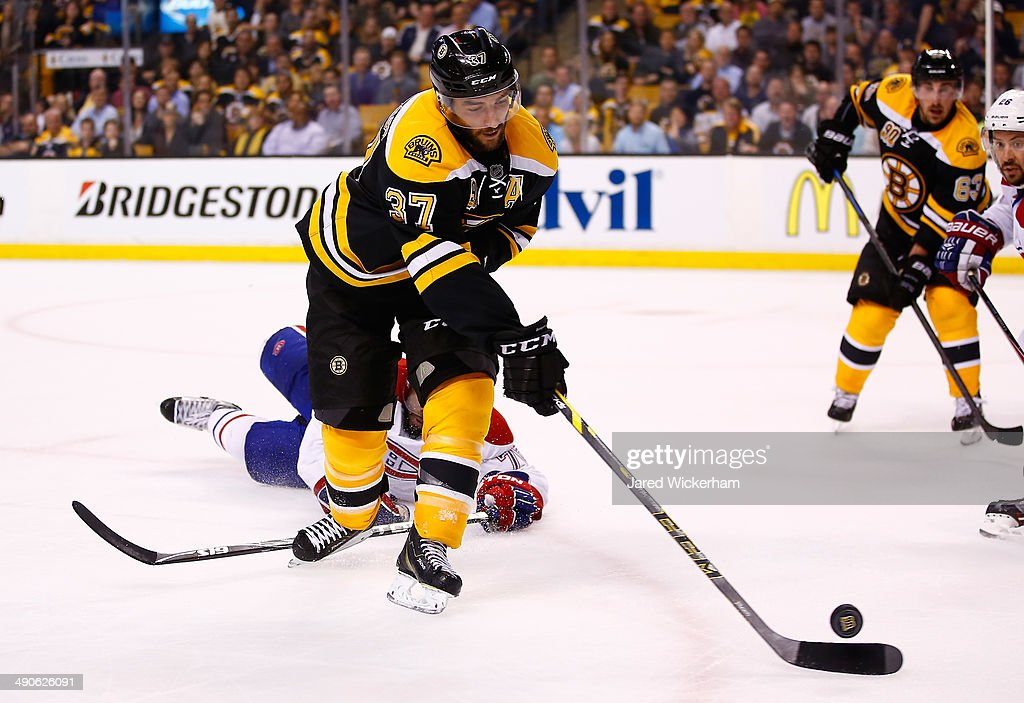 Patrice Bergeron #37 of the Boston Bruins goes for a loose puck against the Montreal Canadiens during Game Seven of the Second Round of the 2014 NHL Stanley Cup Playoffs at the TD Garden on May 14, 2014 in Boston, Massachusetts.