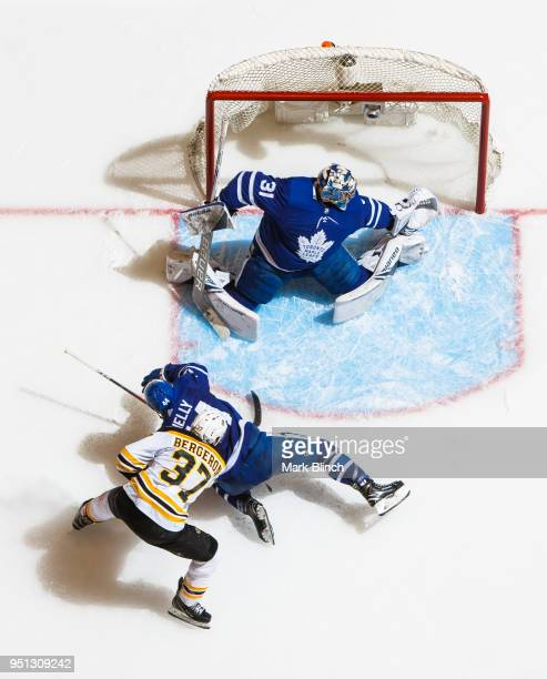 Patrice Bergeron of the Boston Bruins goes to the net against Morgan Rielly and Frederik Andersen of the Toronto Maple Leafs in Game Six of the...