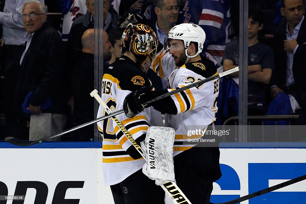 Patrice Bergeron #37 of the Boston Bruins hugs teammate Tuukka Rask #40 after defeating the New York Rangers in Game Three of the Eastern Conference Semifinals during the 2013 NHL Stanley Cup Playoffs at Madison Square Garden on May 21, 2013 in New York City. The Boston Bruins defeated the New York Rangers 2-1.