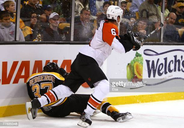 Patrice Bergeron of the Boston Bruins is hit into the boards by Randy Jones of the Philadelphia Flyers on October 27 2007 at the TD Banknorth Garden...