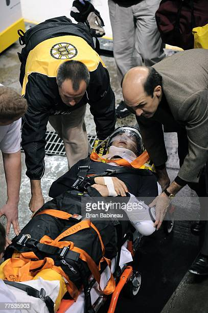 Patrice Bergeron of the Boston Bruins is taken off the ice on a stretcher after he was hit by Randy Jones of the Philadelphia Flyers on October 27...
