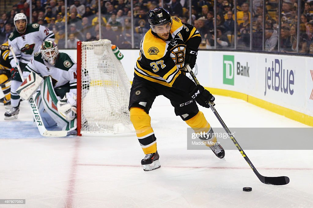 Patrice Bergeron #37 of the Boston Bruins looks for a shot against the Minnesota Wild during the third period at TD Garden on November 19, 2015 in Boston, Massachusetts. The Bruins defeat the Wild 4-2.