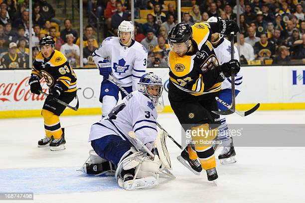 Patrice Bergeron of the Boston Bruins looks for the puck against James Reimer of the Toronto Maple Leafs in Game Seven of the Eastern Conference...