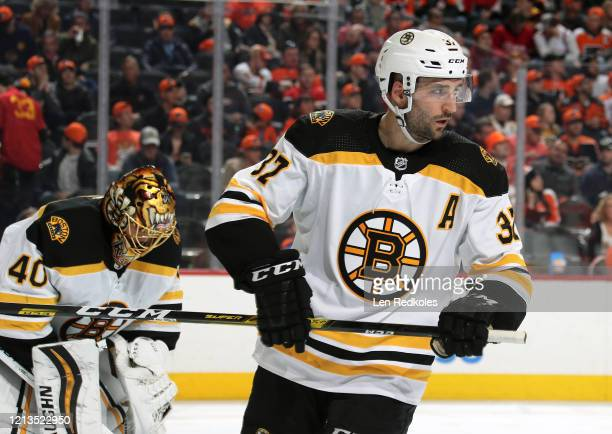 Patrice Bergeron of the Boston Bruins looks on prior to a faceoff against the Philadelphia Flyers on March 10 2020 at the Wells Fargo Center in...
