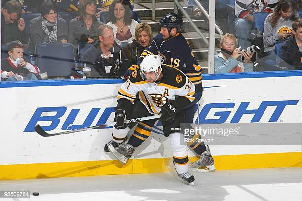 Patrice Bergeron of the Boston Bruins moves for the puck against Tim Connolly of the Buffalo Sabres at HSBC Arena on November 20 2009 in Buffalo New...