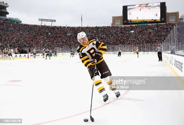 Patrice Bergeron of the Boston Bruins plays during the 2019 Bridgestone NHL  Winter Classic game agaist a70ac25f8