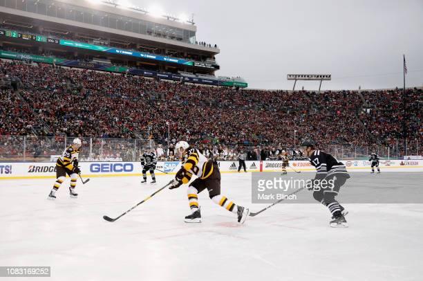 Patrice Bergeron of the Boston Bruins plays during the 2019 Bridgestone NHL  Winter Classic game against 049ef1ea3