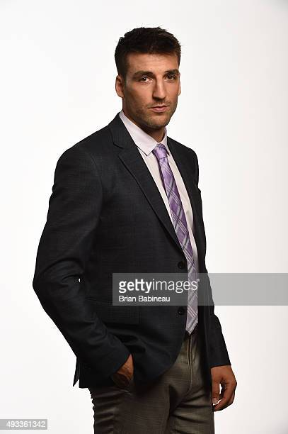 Patrice Bergeron of the Boston Bruins poses for a portrait at the NHL Player Media Tour at the Ritz Carlton on September 8 2015 in Toronto Ontario