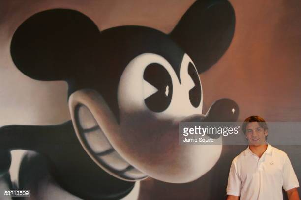 Patrice Bergeron of the Boston Bruins poses for a portrait with Mickey Mouse as a background at Lucky Strike Lanes