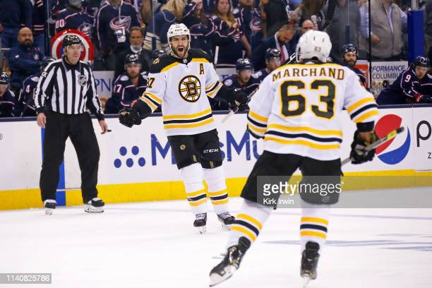 Patrice Bergeron of the Boston Bruins reacts after scoring a power play goal against the Columbus Blue Jackets during the first period in Game Four...