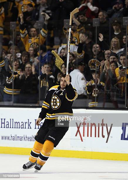 Patrice Bergeron of the Boston Bruins salues the cheering fans after the game against the Ottawa Senators on January 11 2011 at the TD Garden in...