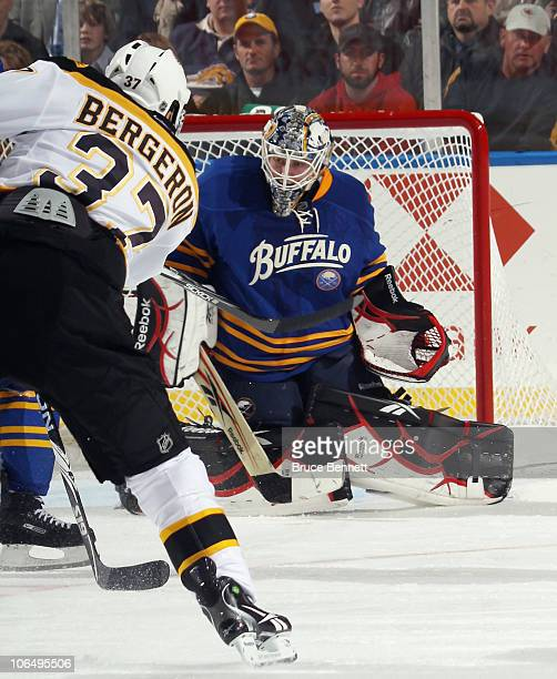 Patrice Bergeron of the Boston Bruins scores a first period shorthanded goal against Jhonas Enroth of the Buffalo Sabres at the HSBC Arena on...