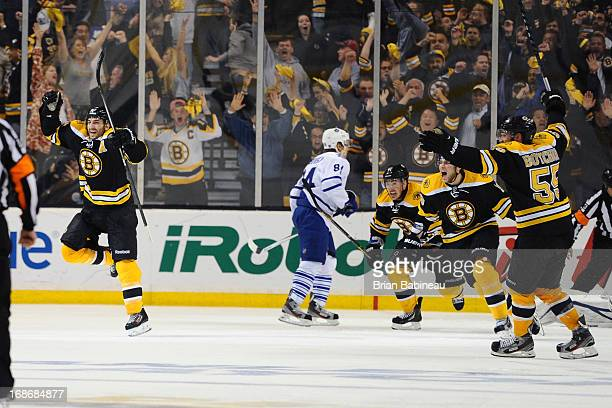 Patrice Bergeron of the Boston Bruins scores a goal in overtime against the Toronto Maple Leafs in Game Seven of the Eastern Conference Quarterfinals...