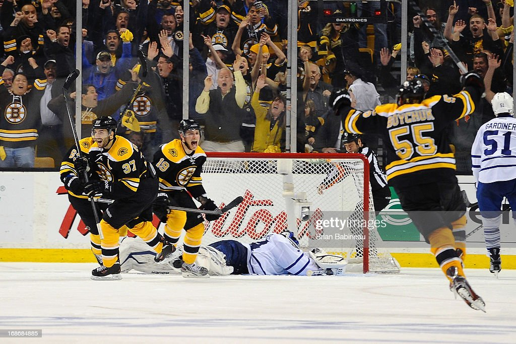 Patrice Bergeron #37 of the Boston Bruins scores a goal in overtime to win the game against the Toronto Maple Leafs in Game Seven of the Eastern Conference Quarterfinals during the 2013 NHL Stanley Cup Playoffs at TD Garden on May 13, 2013 in Boston, Massachusetts.