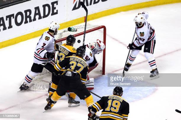 Patrice Bergeron of the Boston Bruins scores a goal in the second period against Corey Crawford of the Chicago Blackhawks in Game Four of the 2013...