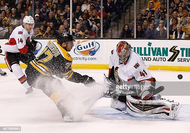 Patrice Bergeron of the Boston Bruins scores by Craig Anderson of the Ottawa Senators in the 1st period at TD Garden on February 8 2014 in Boston...