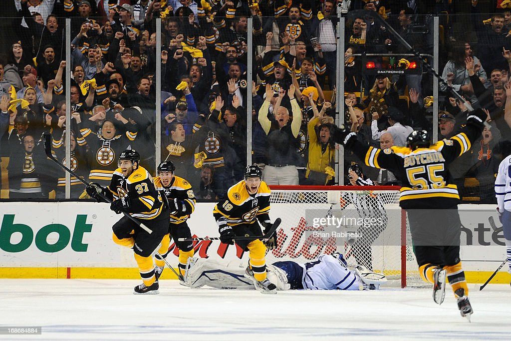 Patrice Bergeron #37 of the Boston Bruins scores in overtime against the Toronto Maple Leafs in Game Seven of the Eastern Conference Quarterfinals during the 2013 NHL Stanley Cup Playoffs at TD Garden on May 13, 2013 in Boston, Massachusetts.