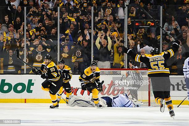 Patrice Bergeron of the Boston Bruins scores in overtime against the Toronto Maple Leafs in Game Seven of the Eastern Conference Quarterfinals during...
