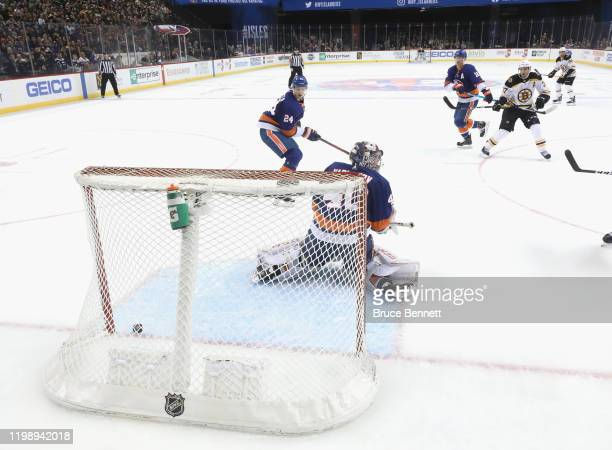 Patrice Bergeron of the Boston Bruins scores the game winning powerplay goal at 233 of overtime against Semyon Varlamov of the New York Islanders at...