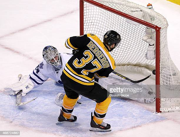 Patrice Bergeron of the Boston Bruins scores the game winning goal during the overtime shootout on James Reimer of the Toronto Maple Leafs The Boston...