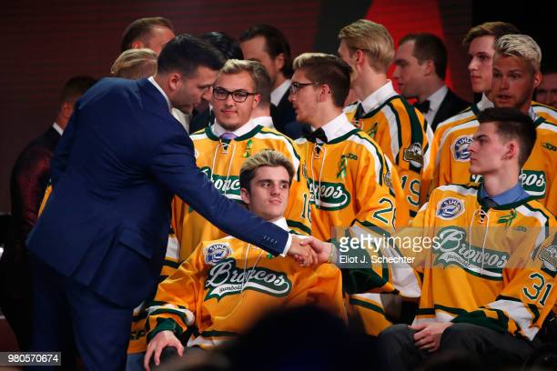 Patrice Bergeron of the Boston Bruins shakes the hand of Jacob Wassermann of the Humboldt Broncos during the 2018 NHL Awards presented by Hulu at The...