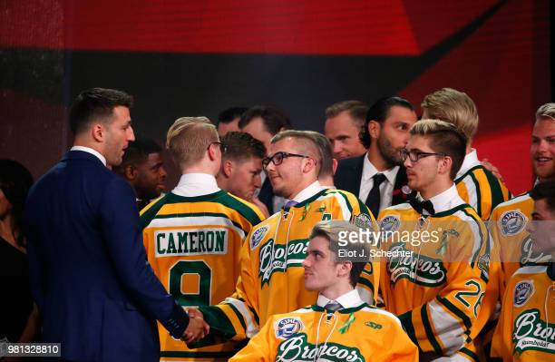 Patrice Bergeron of the Boston Bruins shakes the hand of Kaleb Dahlgren of the Humboldt Broncos during the 2018 NHL Awards presented by Hulu at The...