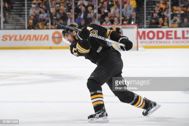Patrice Bergeron of the Boston Bruins shoots the puck against the Pittsburgh Penguins at the TD Garden on March 18 2010 in Boston Massachusetts