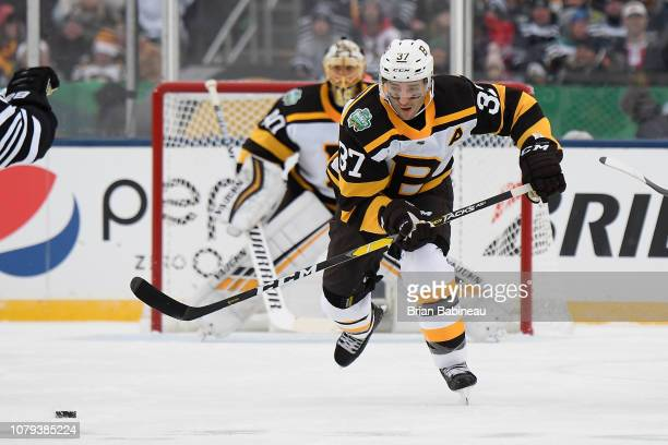 Patrice Bergeron of the Boston Bruins skates after the puck during the 2019  Bridgestone NHL Winter 506adca02