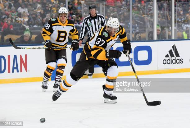 Patrice Bergeron of the Boston Bruins skates after the puck in the first  period of the. 2016 Bridgestone NHL Winter Classic ... 5f31e98d6