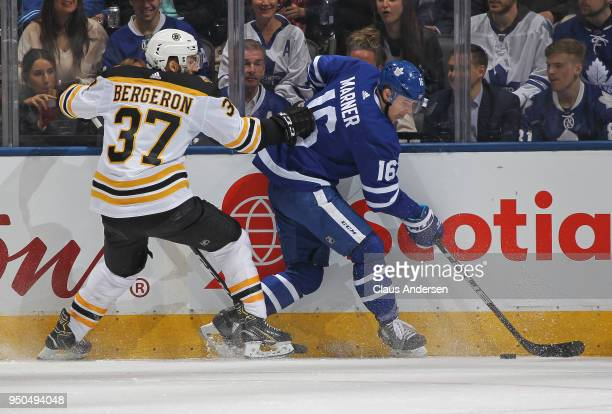 Patrice Bergeron of the Boston Bruins skates against Mitchell Marner of the Toronto Maple Leafs in Game Six of the Eastern Conference First Round in...