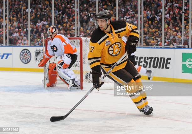 Patrice Bergeron of the Boston Bruins skates up the ice against the Philadelphia Flyers in the 2010 Bridgestone Winter Classic at Fenway Park on...