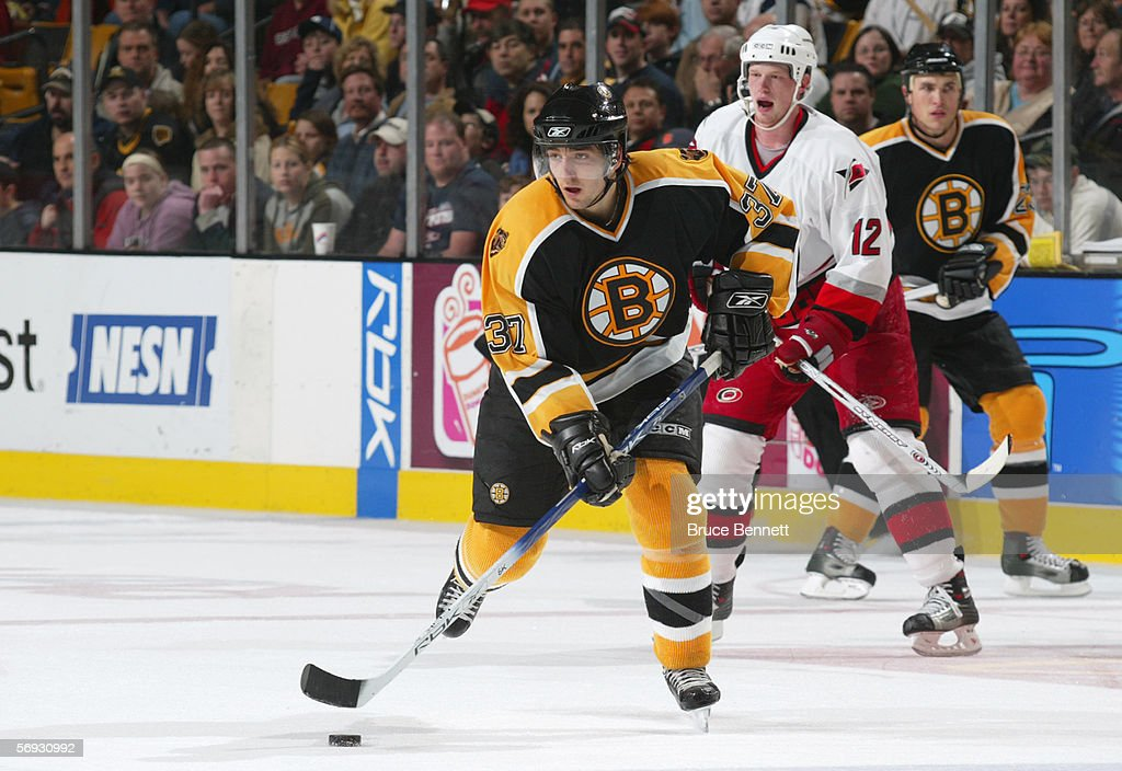 Patrice Bergeron #37 of the Boston Bruins skates with the puck against the Carolina Panthers on February 5, 2006 at TD Banknorth Garden in Boston, Massachusetts. The Hurricanes won 4-3 in a shootout.