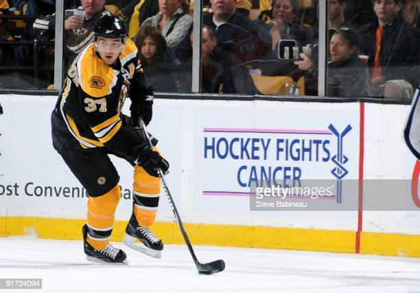 Patrice Bergeron of the Boston Bruins skates with the puck against the New York Islanders at the TD Garden that displays a 'Hockey Fights Cancer'...