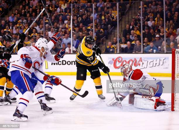 Patrice Bergeron of the Boston Bruins takes a shot on goal in front of Carey Price of the Montreal Canadiens in the first period in Game One of the...