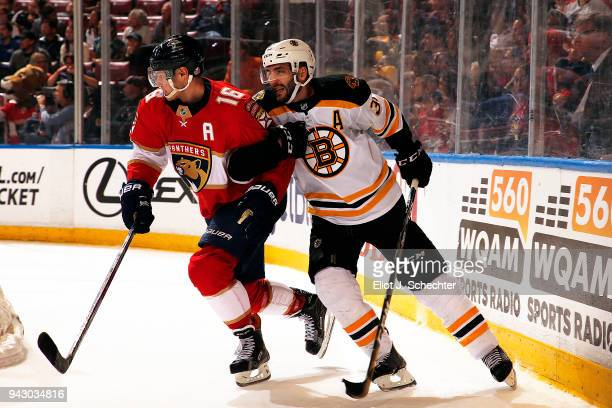 Patrice Bergeron of the Boston Bruins tangles with Aleksander Barkov of the Florida Panthers at the BBT Center on April 5 2018 in Sunrise Florida...