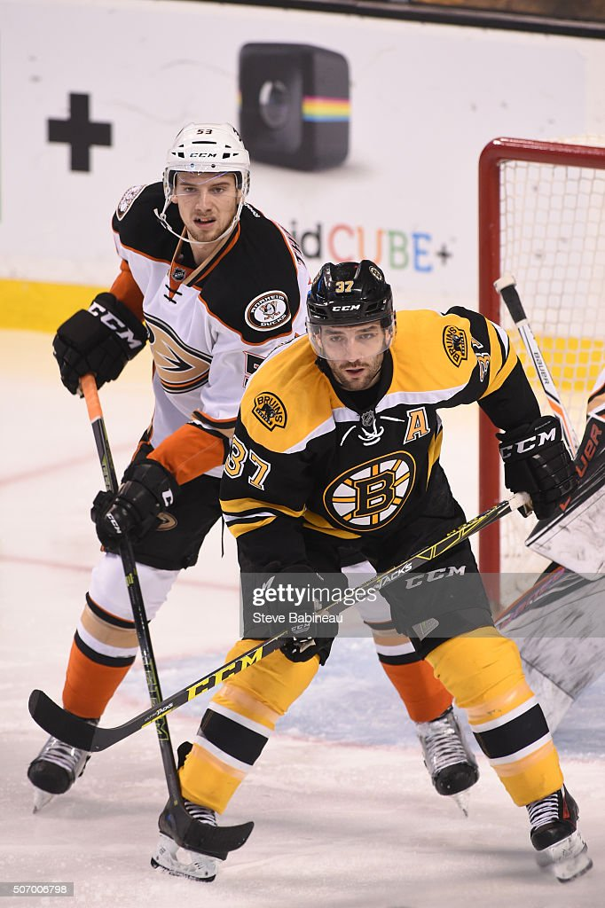 Patrice Bergeron #37 of the Boston Bruins watches the play against Shea Theodore #53 of the Anaheim Ducks at the TD Garden on January 26, 2016 in Boston, Massachusetts.