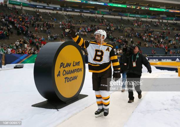Patrice Bergeron of the Boston Bruins waves to the fans on his way back to  the. 2019 Bridgestone NHL Winter Classic ... 35214bec7