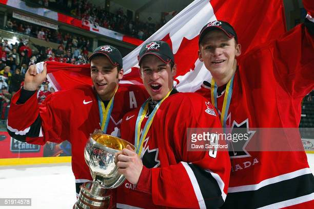 Patrice Bergeron Sidney Crosby and Corey Perry of Team Canada celebrate their gold medal win after beating Team Russia during the gold medal game at...
