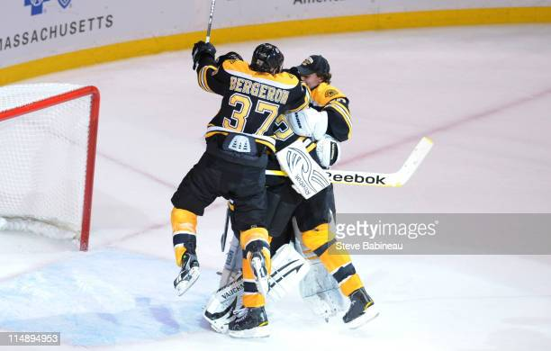 Patrice Bergeron Tim Thomas and Tuukka Rask of the Boston Bruins celebrates winning against the Tampa Bay Lightning in Game Seven of the Eastern...