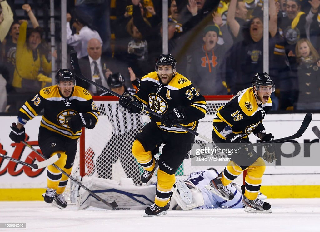 Patrice Bergeron #37, Tyler Seguin #19, and Brad Marchand #63 of the Boston Bruins celebrate following Bergeron's game-winning overtime goal against the Toronto Maple Leafs in Game Seven of the Eastern Conference Quarterfinals during the 2013 NHL Stanley Cup Playoffs on May 13, 2013 at TD Garden in Boston, Massachusetts.