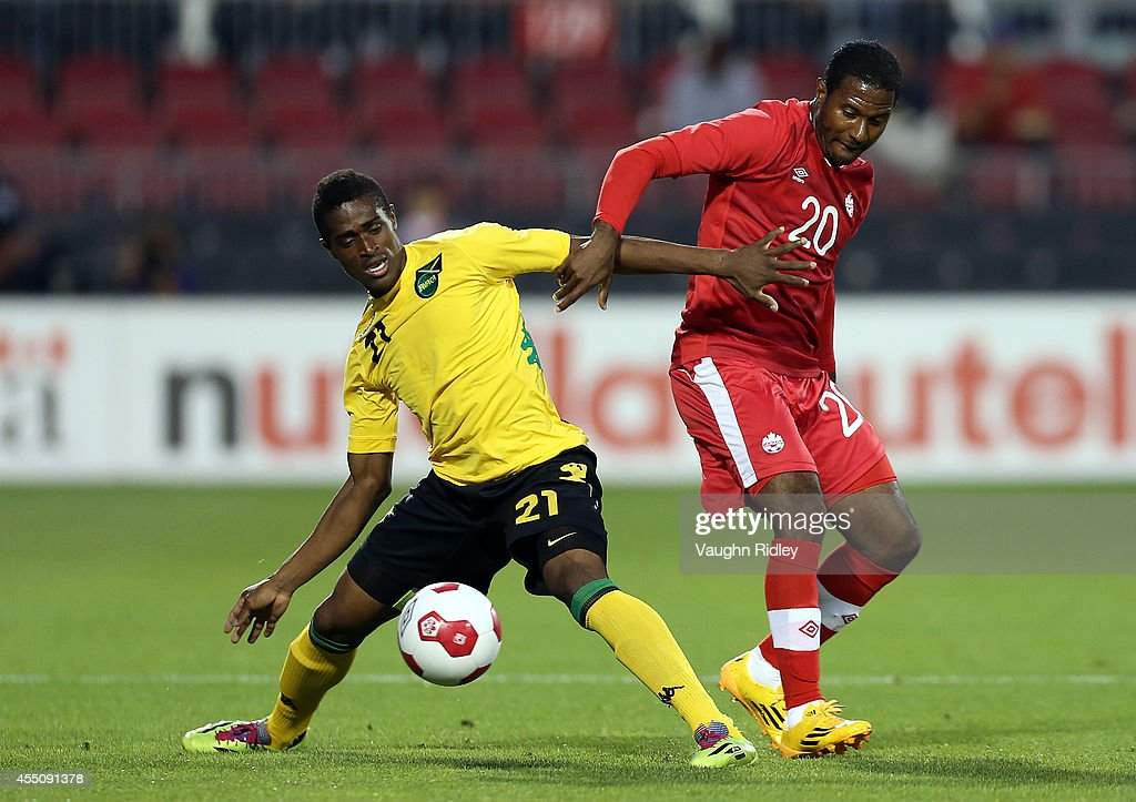 Patrice Bernier of Canada battles for the ball with Deshorn Brown of Jamaica during the International Friendly match between Canada and Jamaica at BMO Field on September 09, 2014 in Toronto, Ontario, Canada.