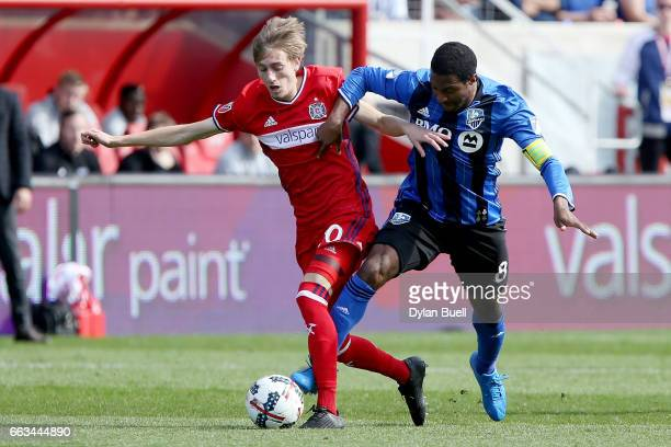 Patrice Bernier of Montreal Impact fouls Daniel Johnson of Chicago Fire in the second half during an MLS match at Toyota Park on April 1 2017 in...
