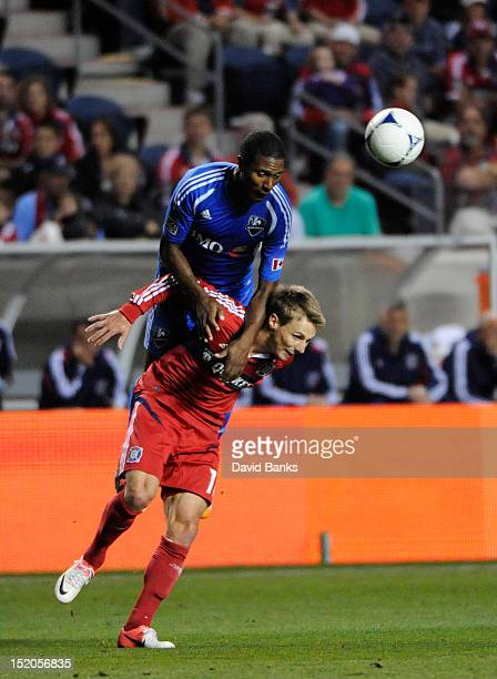 Patrice Bernier of Montreal Impact jumps on the back of Chris Rolfe of Chicago Fire in an MLS match on September 15 2012 at Toyota Park in Bridgeview...